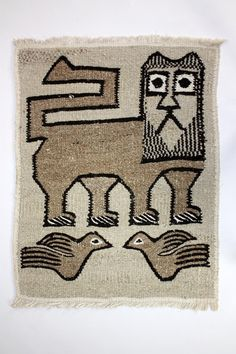 Handwoven Ethiopian Lion and Dove Rug from Lalibela. ~this would be super cute in a childs room!