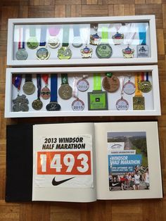 Box Frames displaying medals in date order and photo album containing race bibs and photos