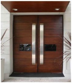 M027 1 puerta doble de entrada de madera con acero for Disenos de puertas principales de madera
