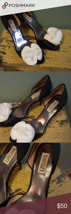 """Badgley Mischka Women's Thora D'Orsay Pump SZ 8 These Black and White Badgley Mischka Women's Thora D'Orsay Pumps are in good used condition. You can see the minimal wear in the pictures.   Satin Fabric Imported Leather sole Heel measures approximately 3.5"""" Peep-toe dress pump in d'Orsay silhouette with layered silk flower and covered  Perfect for your Christmas or New Years Holiday Party! I've seen lots of people use these for wedding shoes. Great for a Bridesmaid. Badgley Mischka Shoes…"""
