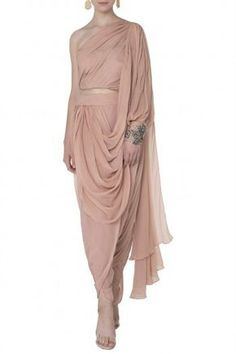 Sonaakshi Raaj  Featuring an onion pink one shoulder dhoti saree in pure georgette and swiss net with stone and bead work.