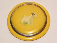 Description I love this powder compact! - Huge Flap Jack measuring inch diameter, it is made of an early yellow celluloid which has survived in very good order, c. 1930 to the top is a Sealyham T. Sealyham Terrier, Vintage Makeup, Vintage Vanity, Vintage Purses, Vintage Handbags, Vintage Antiques, Vintage Items, Art Deco, Lipstick Case