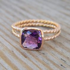 I love everything about this ring Though I have saved some thicker banded rings but I love the look and daintiness of this ring, it's gorgeous, and beautiful in gold, the deep purple is so pretty with the gold