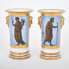PAIR OF BARR, FLIGHT & BARR WORCESTER SPILL VASES, C.1804-13 with blue ground panels painted in bronze, gilt and black with figures of 'Custom' and 'Abundance', stylized gilt foliage on the reverse, the moulded mask handles and borders all gilt, impressed crown and BFB marks, painted titles in red script