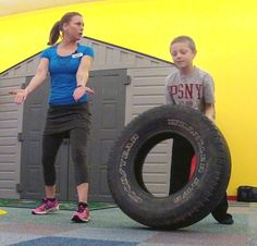 Kids can get in on the tire flip workout, too! They'll have fun and get great exercise.