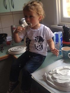 The gorgeous Ollie getting messy in his Young and Moodie footy tee
