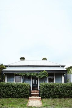A love for gardening and a dream of creating a botanical oasis lead Andrew Lowth and Nigel Smith to purchase a classic. (cottage homes exterior) Cottage Exterior, Interior Exterior, Exterior Colors, Exterior Design, Weatherboard House, Queenslander, Cottage Renovation, Australian Homes, The Design Files