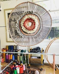 """Tammy Kanat creates textile art that's larger than life. Her colorful, highly-textural wall hangings feature organic circular and oval shapes that are a celebration of materials. """"For me,"""" she says, """"weaving projects a mood. Tapestry Weaving, Loom Weaving, Circular Weaving, Textiles, Textile Fiber Art, Weaving Projects, Woven Wall Hanging, Art And Architecture, Diy And Crafts"""