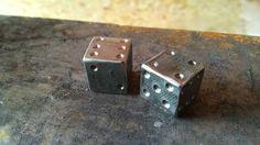These dice are handmade from reclaimed railroad spikes. They are solid steel and very likely to make your friends jealous. They are sold as a set of two dice.