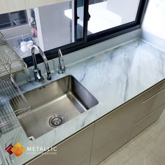 Grey mixed with subtle black marble veins design refurbishing this homeowner's kitchen countertop. Metallic Epoxy Singapore coatings are practical, and aesthetically pleasing. Drop us a message Countertop Redo, Kitchen Countertops, Black Marble, Singapore, Sink, Metallic, Design Ideas, Drop, Flooring