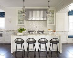 A funny thing how some people insist on those ranges with the red knobs; I wonder how much better they really work? : @alan_s73 #homedecor #homedecoration #homedesign #interiordesign #interiordesigner #interiordesignideas #designdetails #customdesign #kitchen #kitchenisland #barstools #chandelier #ovenhood #rangehood #stainlesssteel #whitekitchen #blueandwhite #dishes #accessories #instagood #inspiration #luxury #mood #JMH #curbed