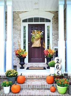 Painted front porch pumpkins---yay or nay? #pumpkins #halloween #diy #frontporch #homes