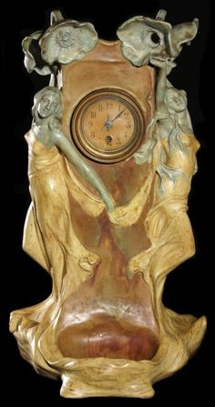 """Figural Art Nouveau Amphora tabletop clock-lamp with receptical base. Maidens with poppy flowers. Artist signed. Dimensions: 24.5"""" high , 12"""" wide , 11"""" deep."""