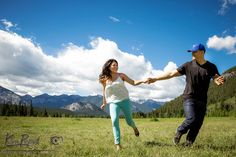 Banff Engagement Photographer, Banff E-Session, Banff Lifestyle Portrait, Banff outdoor portrait, couple running in a field, www.kimpayantphotography.com