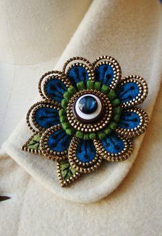 Felt and zipper  flower brooch deep turquoise by Odile Gova of woollyfabulous on Etsy