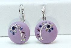 Polymer Clay Purple earrings with crystal clay  zirconium cubes and Swarovski chatons. $25.00, via Etsy.