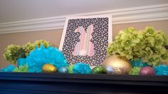 Easter on a budget. My daughter and I found the aqua tin plant pots at DollarTree, regular party decorations and then added easter eggs. She made the bunny paper craft with a cotton ball tail and we framed it into an Ikea art frame. Her favourites colours are aqua and lime green. She's 12 with a knack off how to decorate on a budget. Silk Hydrangeas we found at a Dollarama too.