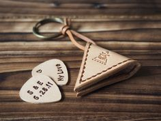 The Pick Holder is constructed out of vegetable tanned leather. Comes with a personalized Hand Stamped Leather Guitar Pick for FREE.  A perfect gift for the musician in your life, man or woman. Great for Birthday, Father's Day, Valentine's Day, Anniversaries, Groomsmen gifts, etc.  The leathe...