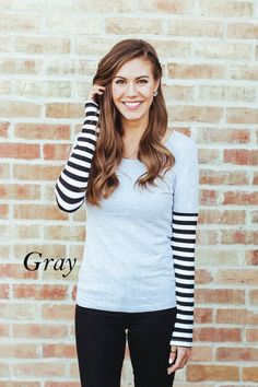 How fun and unique is our Striped Sleeve Top?We love that it gives that layered look without the extra material.This top will surely stand out in your wardrobe and easily become one of your go-to tops!We suggest styling our Striped Sleeve Top with leather leggings, black heeled booties, and a leather jacketColor Options: BlackWhiteGraySize Options: Small- Dress size 0-4Medium- Dress size 6-8Large- Dress size 8-10Mo...