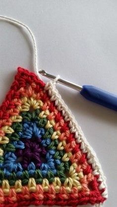 Crochet single or multi - coloured triangles. Maybe -> blanket in lines, or…