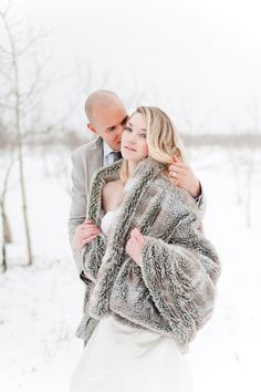 Western Inspired Wedding Shoot in the Canadian Rockies with Banff Wedding Planner, Naturally Chic. Bride in the snow wearing faux fur shawl.
