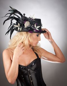 Hey, I found this really awesome Etsy listing at http://www.etsy.com/listing/112652537/ooak-feather-burlesque-top-hat-with