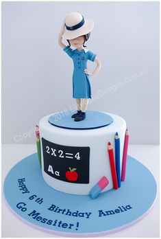 Girls birthday cake featuring a detailed schoolgirl figurine! School uniform can be customised