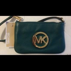 "NWT Michael Kors stunning green leather wristlet! NWT Michael Kors stunning green leather wristlet!!!! Gorgeous soft green fulton green leather, this wristlet is truly a stunner!!!!  Measures 7"" in length & 4 1/2"" in height Michael Kors Bags"