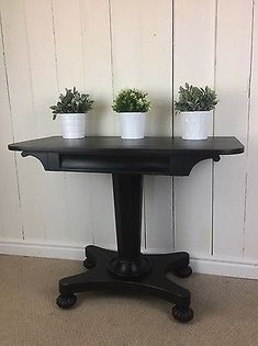 Single Pedestal Hall Table Painted In Black, Elegant Console Table, Solid Wood www.furniturerecyclingshop.co.ukPaymentShippingReturn PolicyWhere to Find Our ShopAbout UsWhere to Find Our ShopAddress: The Furniture Recycling Shop, 1A Station Road, Bourne End, Buckinghamshire SL8 5QE  The Furniture Recycling Shop is located opposite Bourne End Rail Station. There is on-site car parking with additional pay and display car parking next to the train station. If you have any problems finding us…
