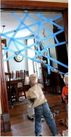 "Painter's tape and some balled-up newspaper are all you need for this ""sticky spiderweb"" activity. 