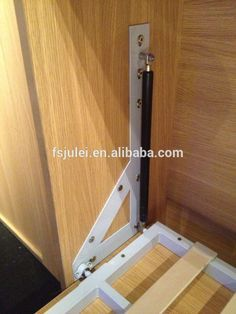 Murphy bed gas piston with corner brackets