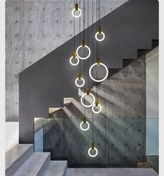 #light #chandelier #stairs #concrete #metal #glass #perfect #combination #circles #modern #interior #interiordesign #design #designer #inspiration #creative #art#architect#architecture#idea#tips#home#homedesign#innovative#new#grey#beautiful by meublesdart http://discoverdmci.com