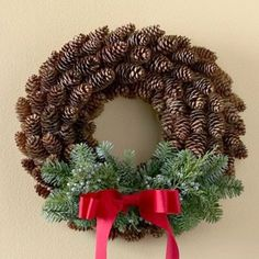 Use red ribbon and cinnamon scented pine cones for a non-cluttered but classy front door Christmas decoration; could also be placed onto windows (indoor) and cabinets (instead of a wreath). Description from pinterest.com. I searched for this on bing.com/images