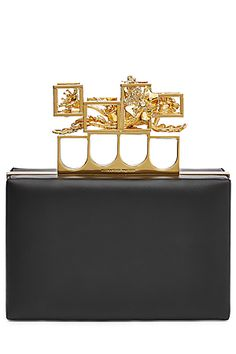 Streamlined and statement, this black leather box clutch is a signature style to Alexander McQueen - complete with an embellished gold-tone handle and knuckleduster-inspired toughness #Stylebop