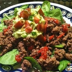 """Grass-fed taco salad with homemade guac and sriracha sauce! (Grass-fed beef seasoned with chili powder, cumin, oregano, pink salt, white pepper, onion powder, and fresh garlic)"" #PrimalBliss"