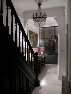 Modern Country Style: The Best Paint Colours For Small Hallways Click through for details. Staircase and front door in Farrow and Ball Railings