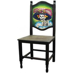 This exquisitely hand-carved and hand-painted Day of the Dead Chair was built with pride by the renowned Perla furniture studio of Michoacan, Mexico. Imagine sitting down to a scrumptious south-of-the-border meal with your family and friends in these eye-catching chairs! A striking and colorful addition to your home decor, they're the perfect way to embrace your own Mexican or Southwestern spirit, and to bring out the interior decorator in all of us!