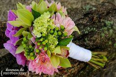 purple phalaenopsis, pink dahlias, green cymbidiums, baby green hydrangeas and green hypericum berries
