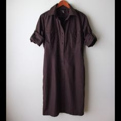 "Bitten brown shirt dress Brown shirt dress - button front closure - roll up sleeves - chest pockets - thin belt loops (add a belt or wear without!) - cotton - chest across measures 21"" - total length measures 39"" - hip measures 20"" flat across - size 10 Bitten  Dresses"