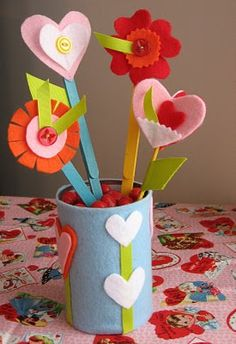 Kate.... since we have all that felt, perhaps we could do felt flowers! I have made them before for my mom, so cute! Valentine's Day or Mother's Day craft.... Crafts for Exceptional # Special Needs....