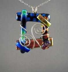 Dichro open square and swirl wire wrapped pendant.Use beach found objects & shell fragments. Dichroic Glass Jewelry, Fused Glass Art, Glass Pendants, Mosaic Glass, Glass Beads, My Glass, Glass Design, Glass Ornaments, Tiffany
