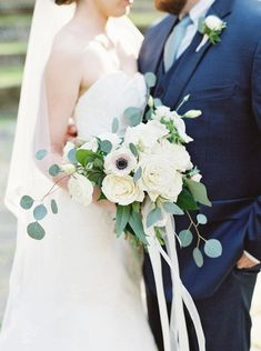 Spring wedding bouquet idea - loose bouquet with cream roses, anemones and greenery + ribbons {Anik Flowers}