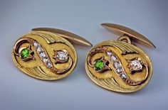 Art Nouveau Diamond and Demantoid Gold Cufflinks, Moscow, 1899-1908. Greenish-yellow 14K gold cufflinks with applied stylized flowers set with sparkling green Russian demantoids, old mine and old rose cut diamonds.