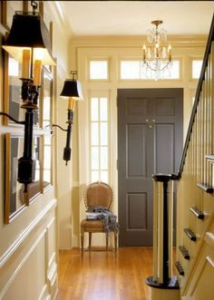 Foyer door: elephant grey~One Feng Shui cure for your stairs facing your front door is to hang a crystal chandelier from the ceiling.