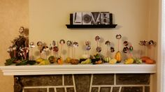 The Love Wall:  When I was growing up, my mom had large red letters spelling LOVE on a long wall with numerous family photo's.  Here is my version of a LOVE mantle with photo gourds.