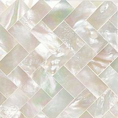 Daltile mother of pearl tile in a herringbone / chevron pattern