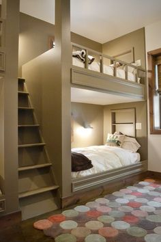 Bunk room with a separate staircase for the top bunk.