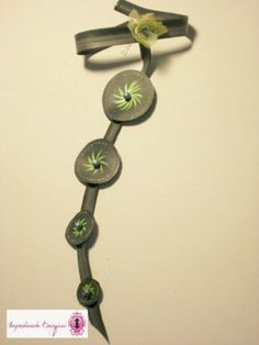 """Bicycle tube becomes a canvas to paint. Handmade jewelry definitely """"over the top""""."""