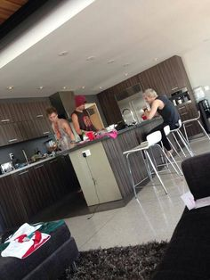 Imagine walking into your kitchen and seeing this<<< I am now mentally screaming, thank you<< I like how no one noticed the fact that there is a bright pink clothing item sitting on the kitchen island. Like the boys would totally wear something that looks like a bright pink lace crop top.