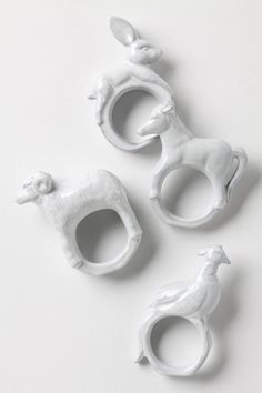 White Porcelain Rings with assorted animal figures; ceramic jewellery art // Anthropologie